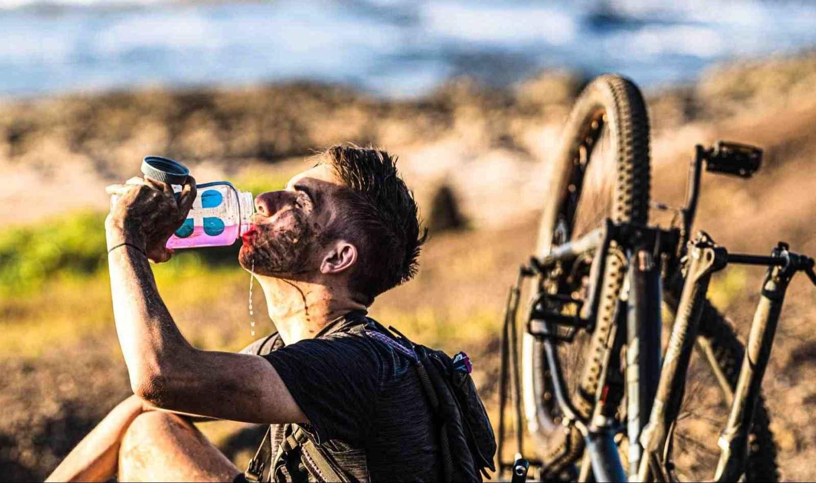 Biker drinking DripDrop ORS