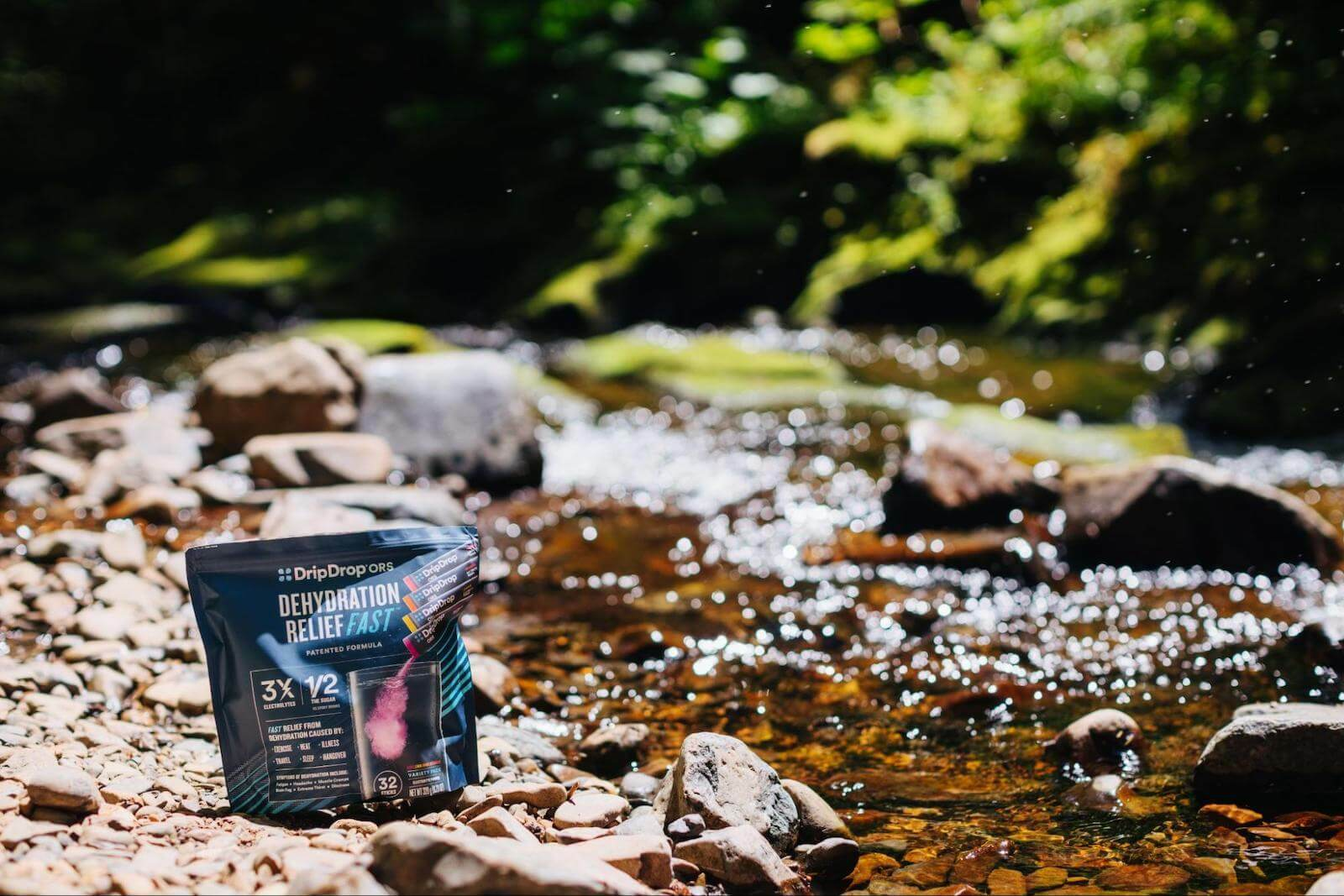 DripDrop ORS pack by a stream