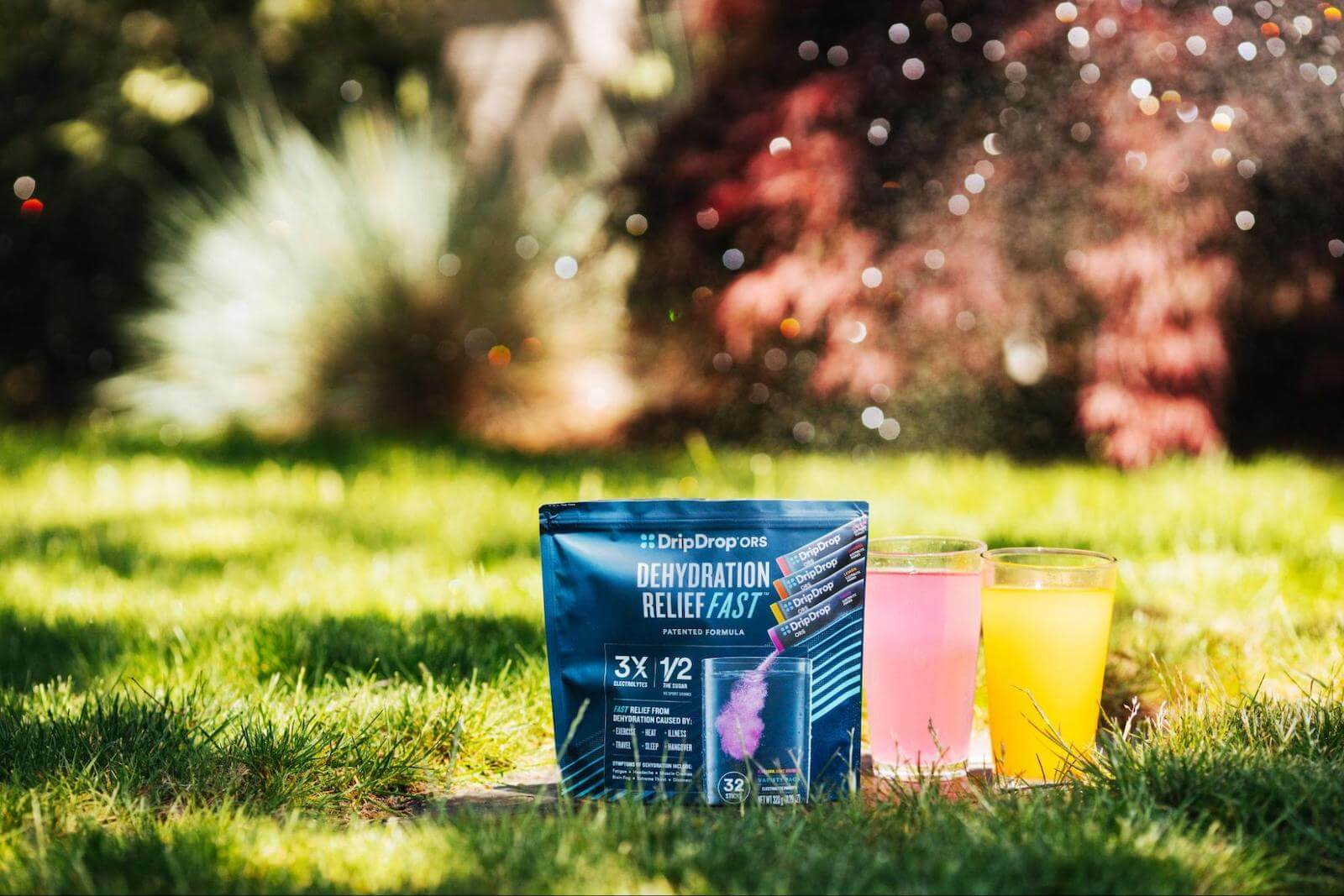 DripDrop pack and drinks on the grass