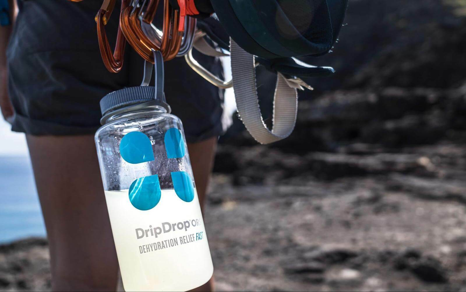 DripDrop tumbler hanging from a carabiner