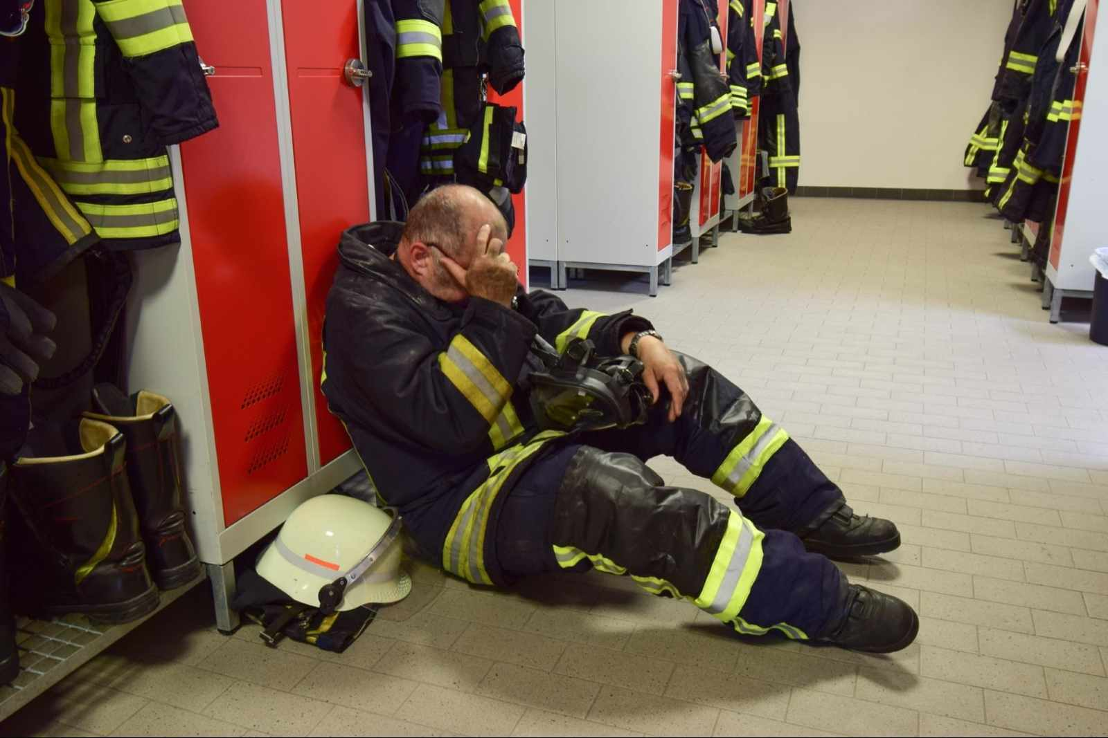 how to rehydrate: Fireman sitting on the floor of a locker room