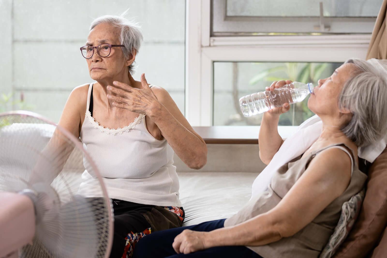 How to treat heat stroke: Elderly women feeling the extreme heat
