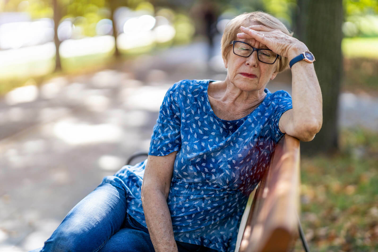 How to cool down: Elderly woman suffering from a headache