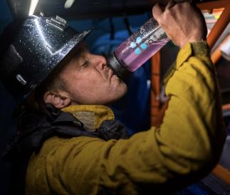 Firefighter drinking DripDrop