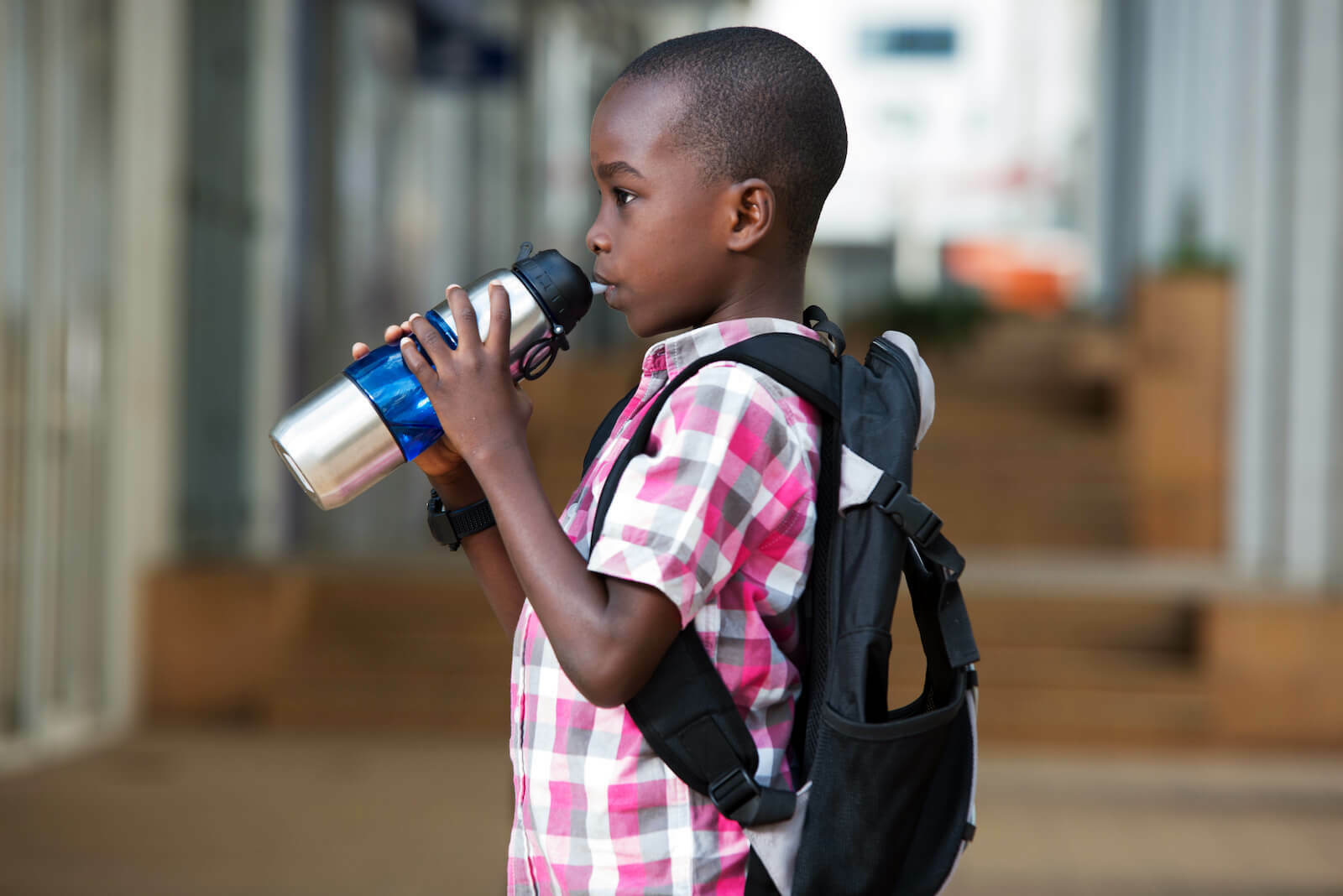 Oral rehydration salts: little boy drinking from a tumbler