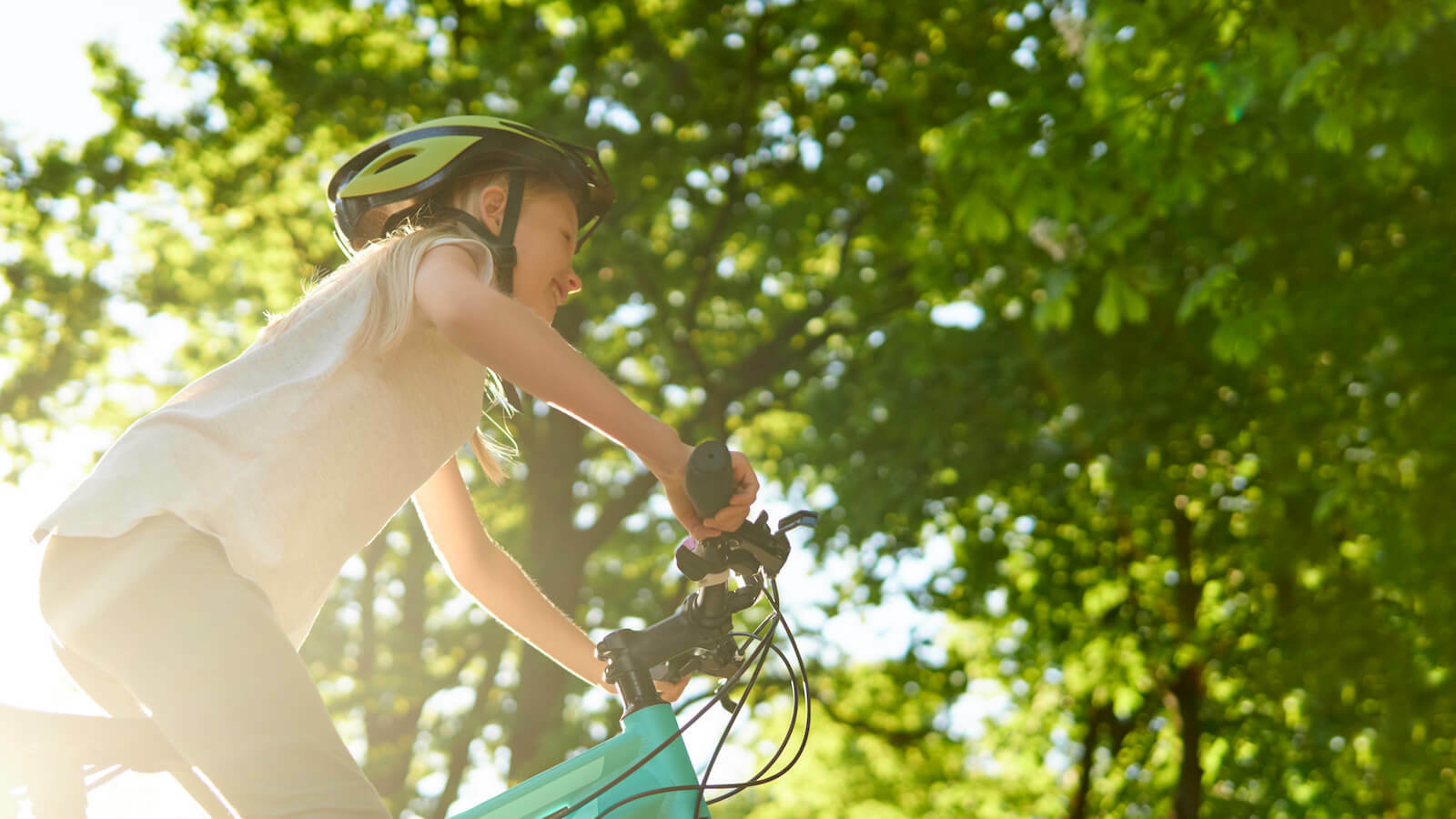 Heat poisoning: little girl cycling outdoors