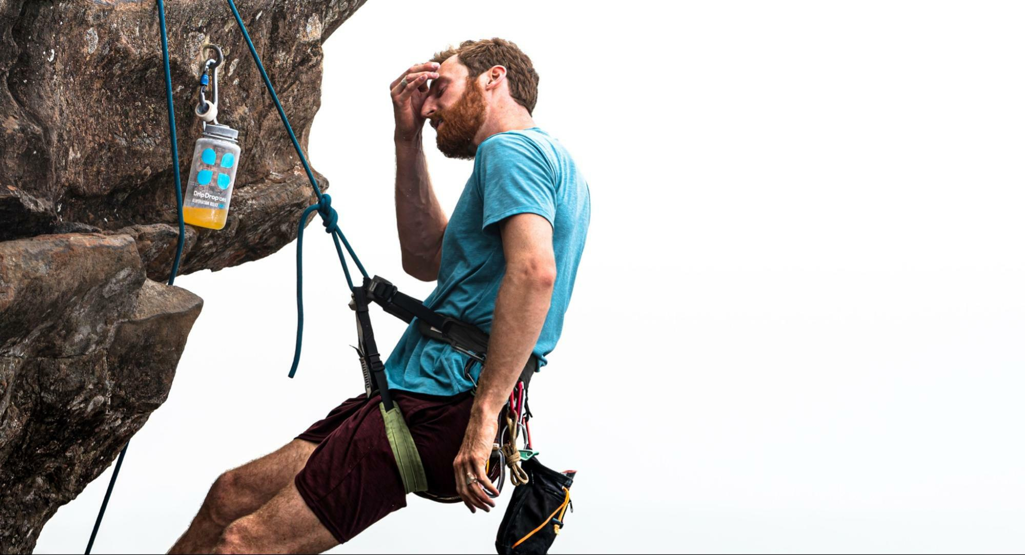 how to hydrate skin: man in a rappel holding his forehead