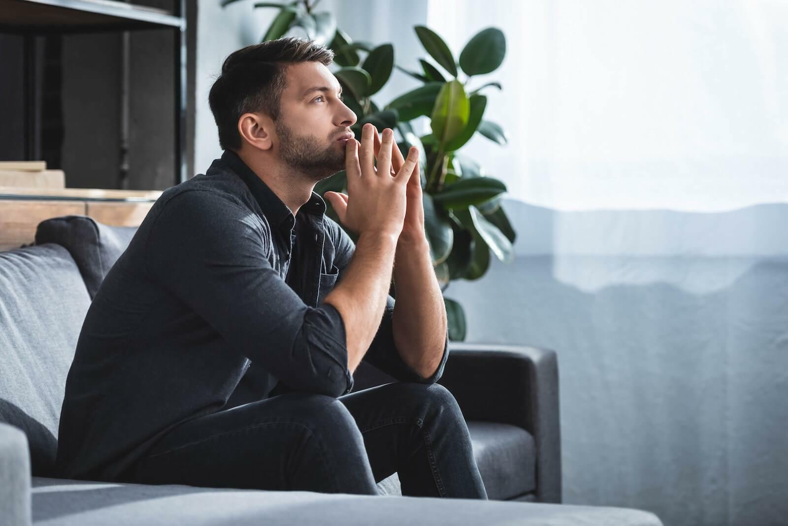 Cold sweats: man in deep thought