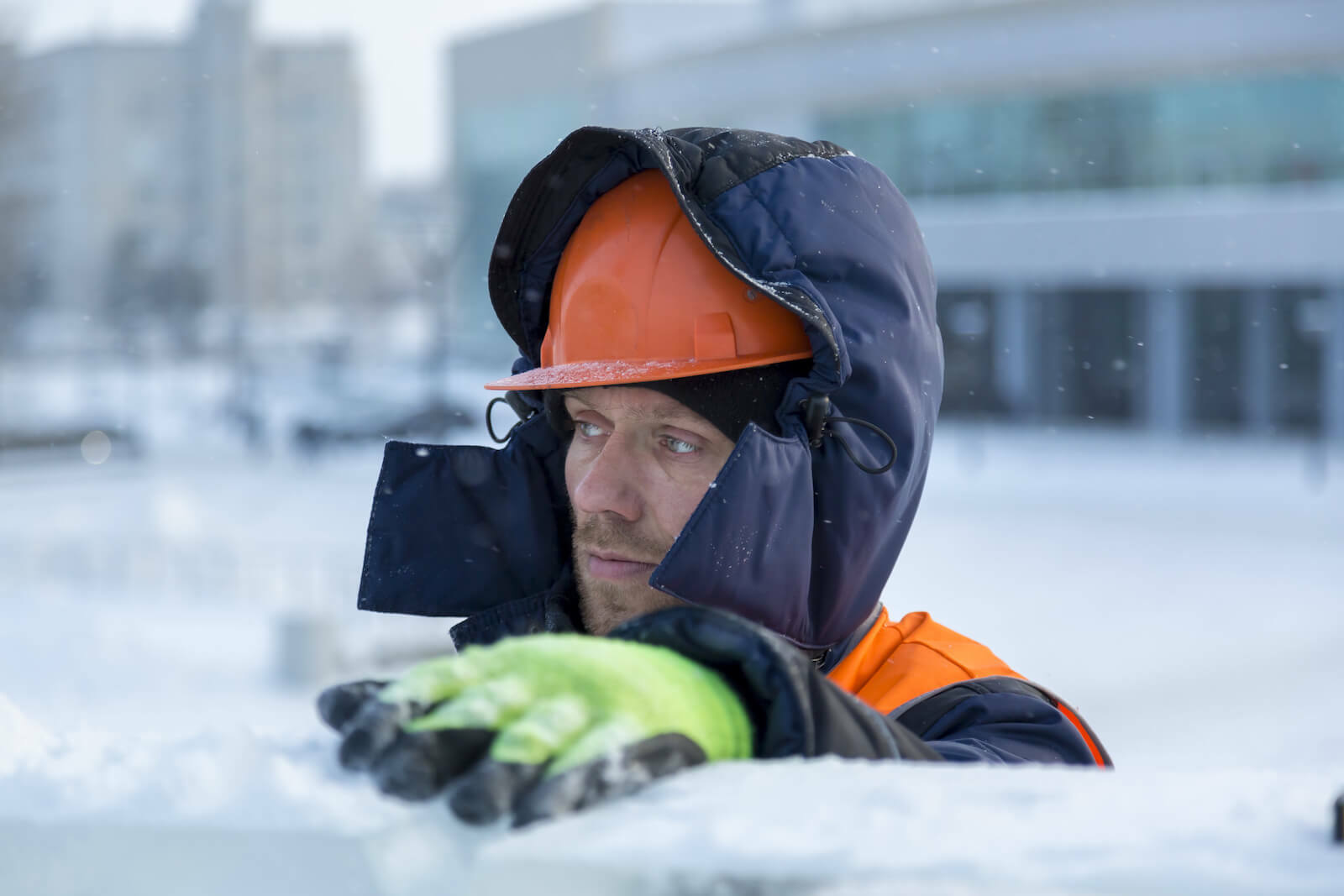 Worker in the snow wearing a hard hat