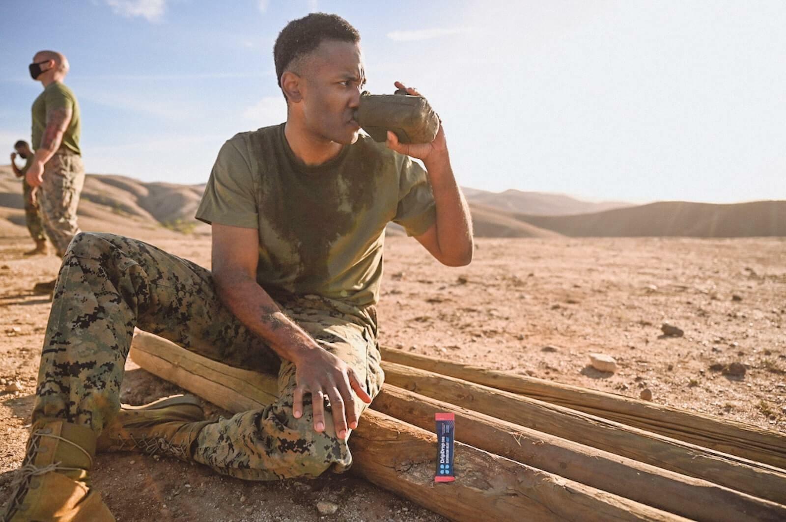 Nausea and sweating: military man drinking DripDrop ORS