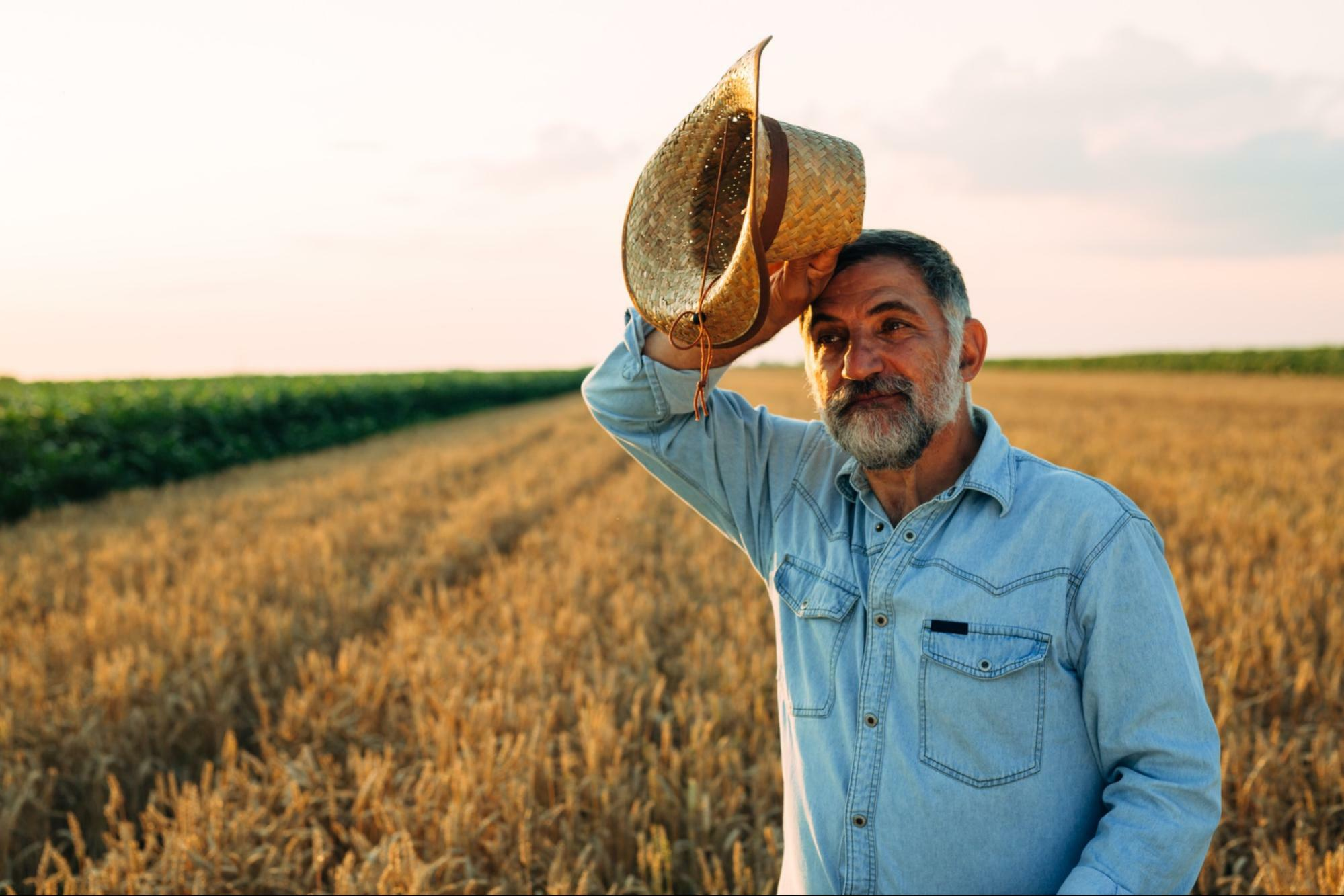 best water to drink for health: old man on the field holding his hat