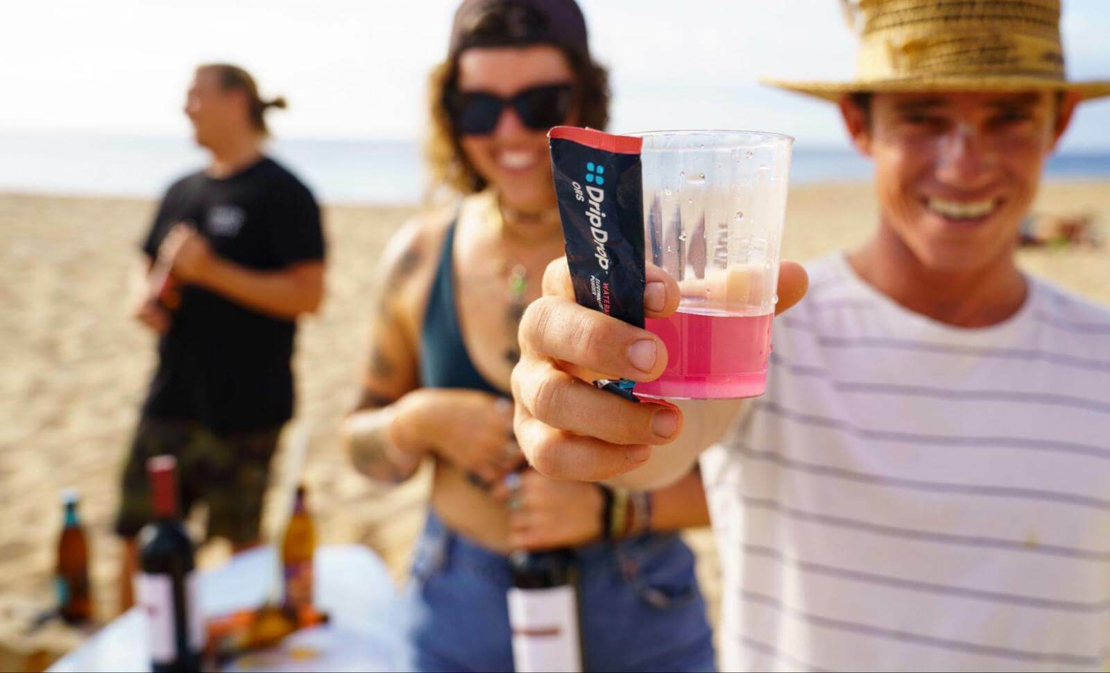 How to cool down: People at the beach with a glass of DripDrop ORS