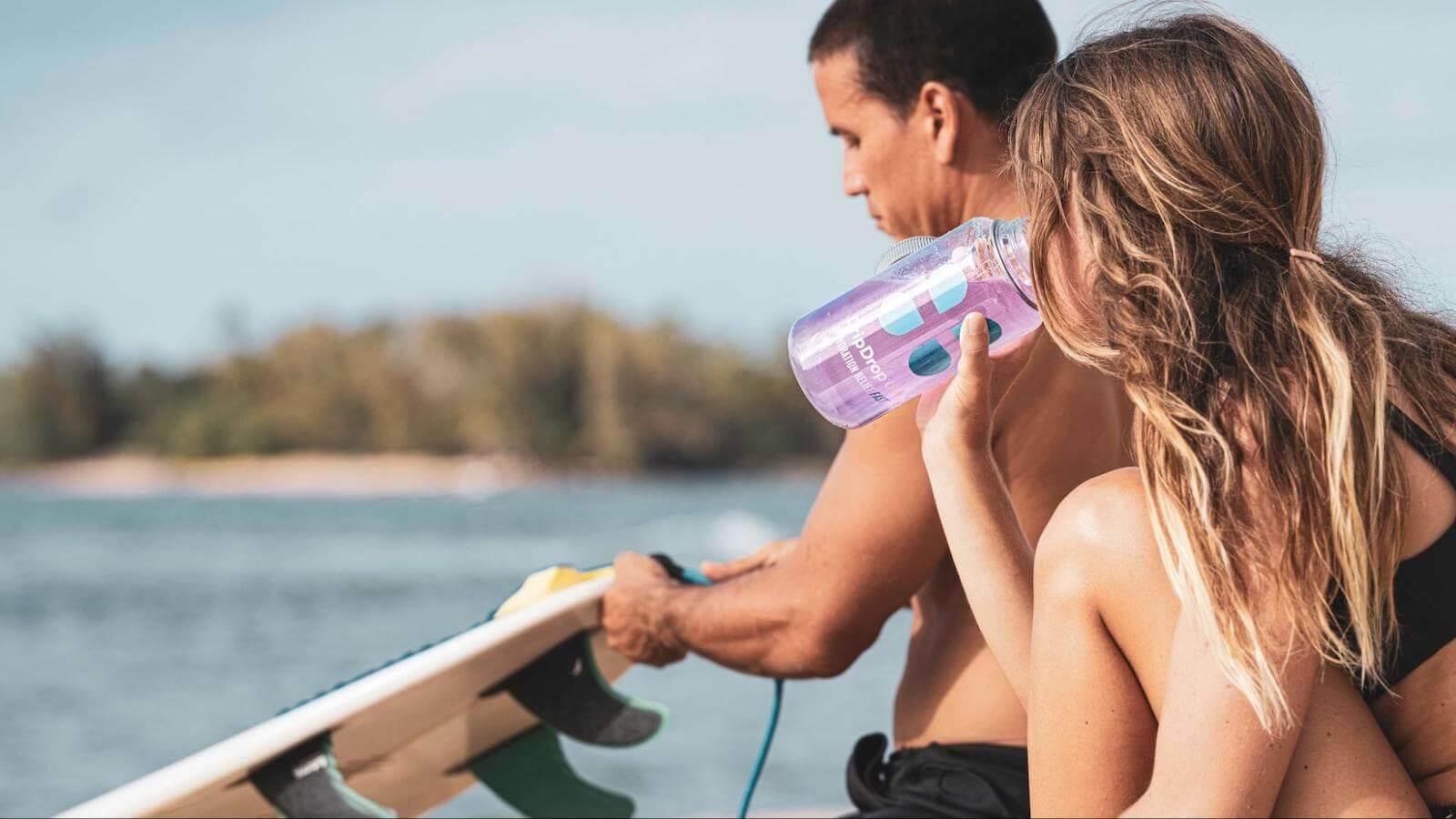 Surfers drinking DripDrop ORS