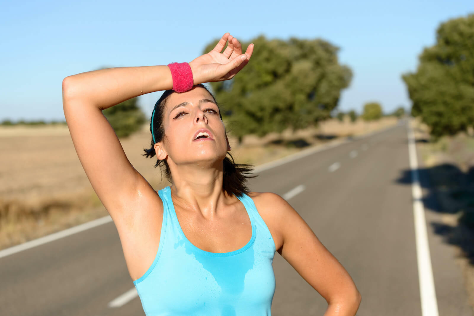 How to cool down: Tired woman sweating from running