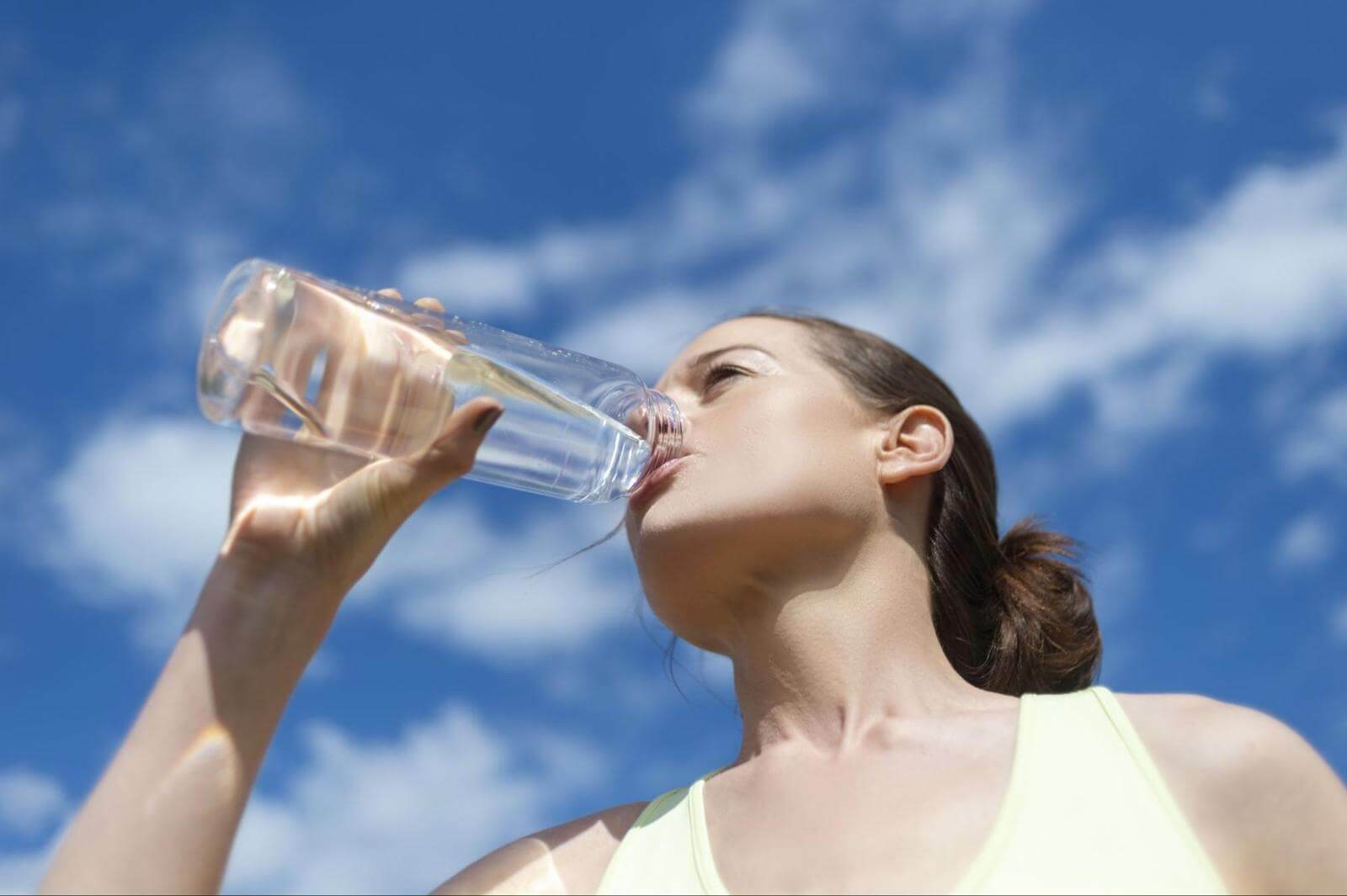 Can you sweat out a cold: woman drinking water from a tumbler