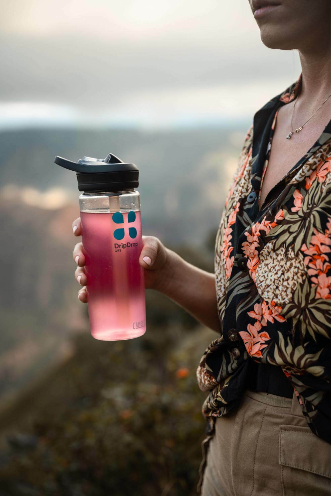 Woman holding a tumbler with DripDrop ORS